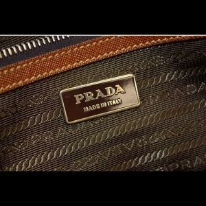 Prada.   Olive awesome roomy tote.  Mint condition
